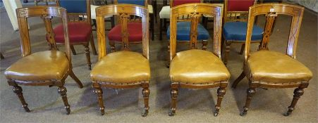 A Set Of Four Late Victorian Gothic Style Oak Dining Chairs, with later tan hide upholstered stuff-