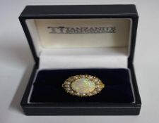 A 9ct Gold Opal & Seed Pearl Dress Ring, the large opal measuring approximately 1cm diameter,