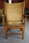 A Reproduction Childs Orkney Chair, with woven back rest and seat, 84cm high