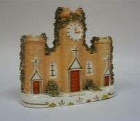 A 19th Century Staffordshire Pottery Spill Holder, in the form of a cathedral with clock face,