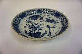 A Chinese Blue & White Dish, in the 18th century style, of circular form, decorated with panels of