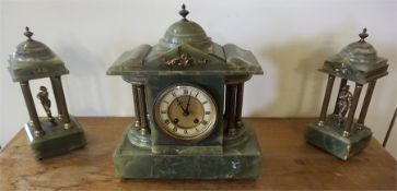 A French Green Onyx Three Piece Clock Garniture, circa early 20th century, comprising of a twin