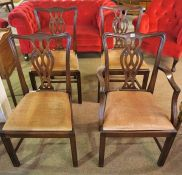 A Set of Seven Mahogany Dining Chairs, in the Georgian style, comprising of one carver and six