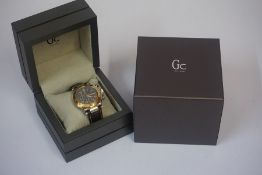 A GC Swiss Made Quartz Chronograph Gents Wristwatch, circa 2012, with a gold plated bezel, the