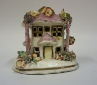 A 19th Century Staffordshire Pottery Pastille Burner, in the form of a house, encrusted with