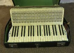 A Hohner Tango III Piano Accordion, Decorated in faux mother of pearl, with carry case