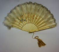 A Japanese Silk Fan, Meiji period, with a feathered fringe top above a painted floral panel, above