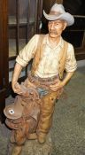 A Large Resin Figure of a Cowboy, With moulded signature to the reverse for Universal, dated 1985,