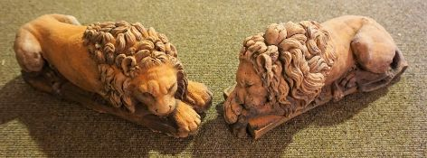 Two Terracotta Recumbent Lion Figures, 30cm long, (2)