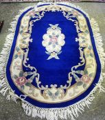 A Small Chinese Style Rug, Decorated with a central floral medallion on a blue ground, 158 x 95cm