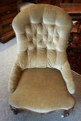 A Victorian Walnut Gossip Chair, Upholstered in button back velour, with serpentine shaped seat,