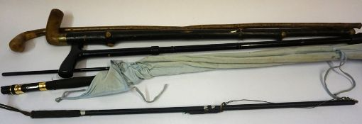 "A Three Piece ""Black Fly"" Fishing Rod by Shakespeare, 1602-300, with carry bag, also with a"