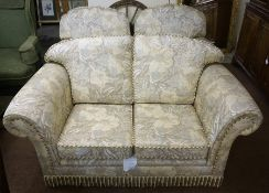 A Modern Three Piece Lounge Suite, Almost new, comprising of a two seater sofa and a pair of