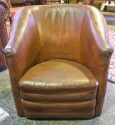 A Tan Leather Tub Armchair, 66cm high