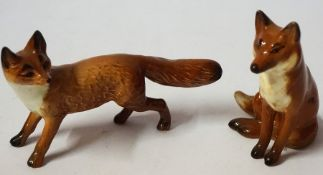 Two Beswick Porcelain Fox Figures, In the form of a seated and standing fox, 7cm high, (2)