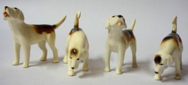 Four Beswick Porcelain Figures of Fox Hounds, Comprising of two pairs of figures, 7cm high, (4)