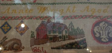 A Victorian Sampler By Annie Wright Aged 5, dated 1864, 39.5 x 41cm, beneath glass, framed