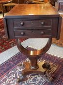 An Early Victorian Mahogany Work Table, With two small drawers and opposing dummy drawers, having