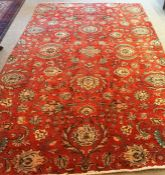 A Large Tabriz Rug, Decorated with all over floral medallions on a red ground, 320 x 185cm