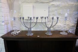 A Pair of Swedish Metal Candleabra, Designed by K Hagberg & M Hagberg, with eight Menora style