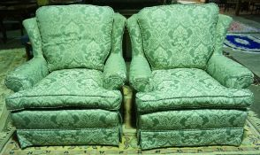 A Pair of Green Damask Easy Armchairs, Decorated with all over floral panels, raised on castors,