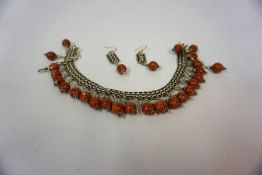 An Indian Style Silver Necklace with Matching Earrings, the necklace is decorated with agate style
