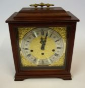 A Mantel Clock by J.W. Benson, with a German movement, the silvered dial with Roman and Arabic
