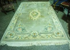 A Large Chinese Style Rug, Decorated with floral panels on a pale ground, 295 x 186cm