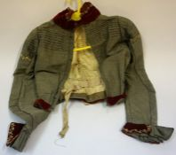 A Victorian Jacket, Decorated with red velour collar and cuffs on a grey fabric, 52cm high