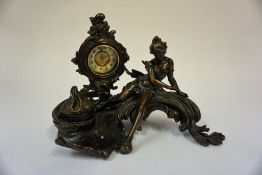 A French Patinated Bronze Figural Mantel Clock, circa early 20th century, with integral inkwell,