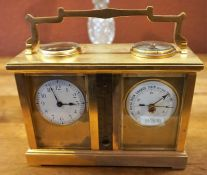 A Gilt Metal Cased Carriage Clock/Barometer, With a compass dial to the top, above a thermometer,