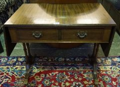 A Mahogany Sofa Style Telephone Table, Raised on scroll supports with castors, 52cm high, 106cm