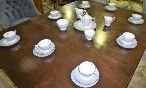 A Minton Part Bone China Tea Service, To include tea pot, cream and sugar, cups and saucers,
