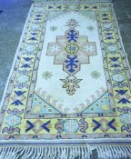 A Turkish Kilim Rug, Decorated with a central geometric medallion, with further geometric motifs