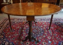 A Victorian Figured Walnut Centre Table, With D shaped drop ends, raised on scroll and plain