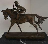 A Cast Bronze Figure Group of a Horse & Jockey, raised on a square plinth base, 25cm high