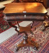 An Early Victorian Mahogany Work Table, With a hinged top enclosing a fitted interior, above a