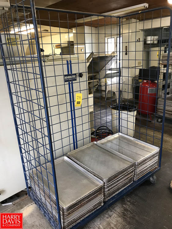 Lot 29 - Perforated Aluminum Sheet Pans and Cart Rigging fee: 25