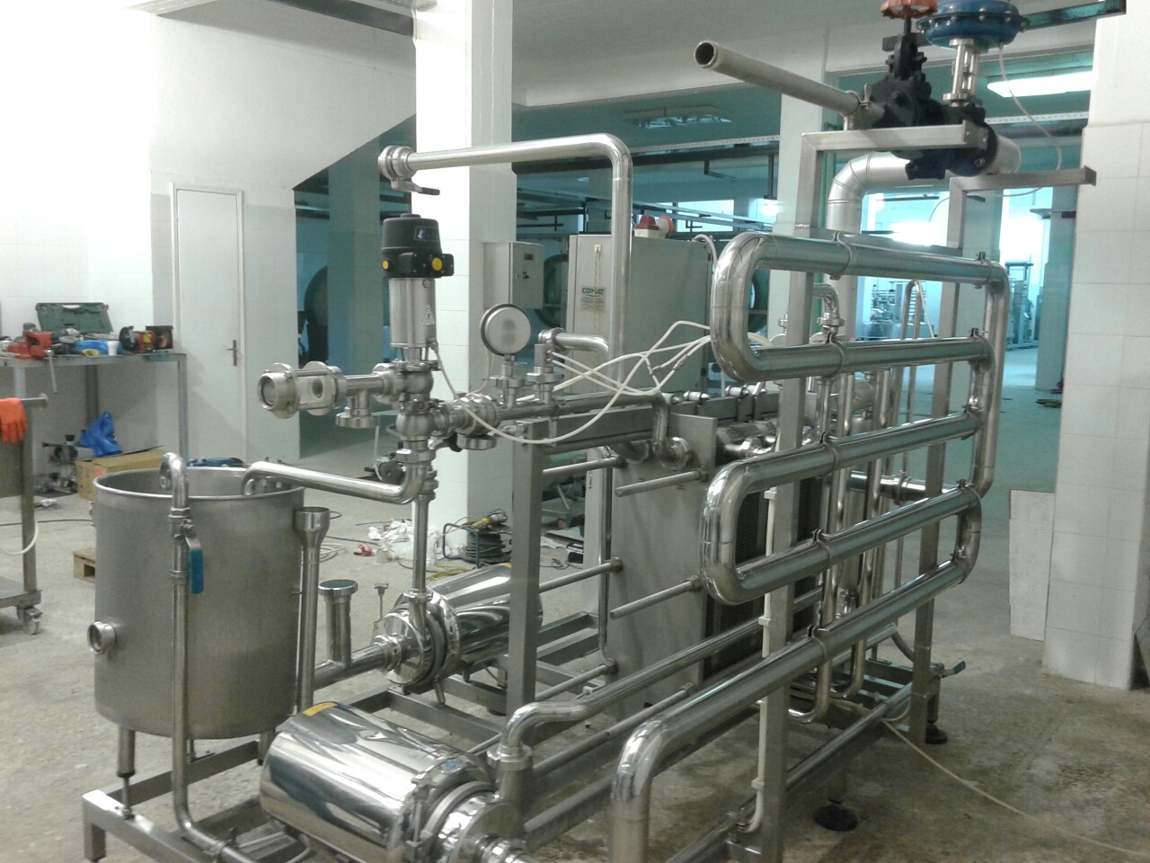 Lot 30 - Comat Skid-Mounted Pasteurizer 6000 Ltr Per Hour, Balance Tank, Two Product Pumps,
