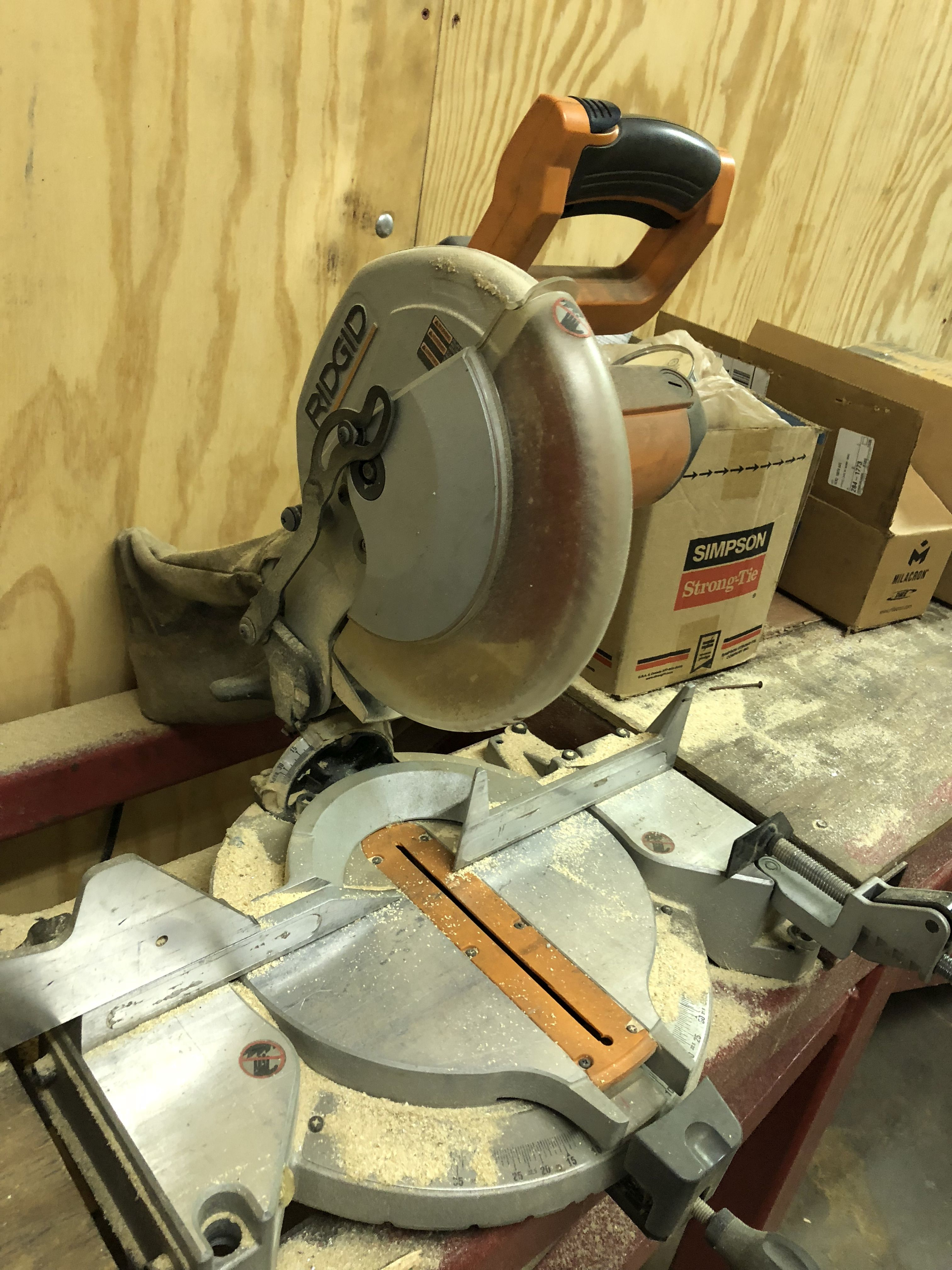 Lot 36 - RIDGID 10''MITER SAW, WITH STEEL TABLE/WOOD TOP, MEASURES 8' LONG x 24'' WIDE x 36'' TALL [