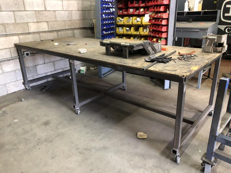 Lot 4 - Steel work table 10'x4', wood top casters