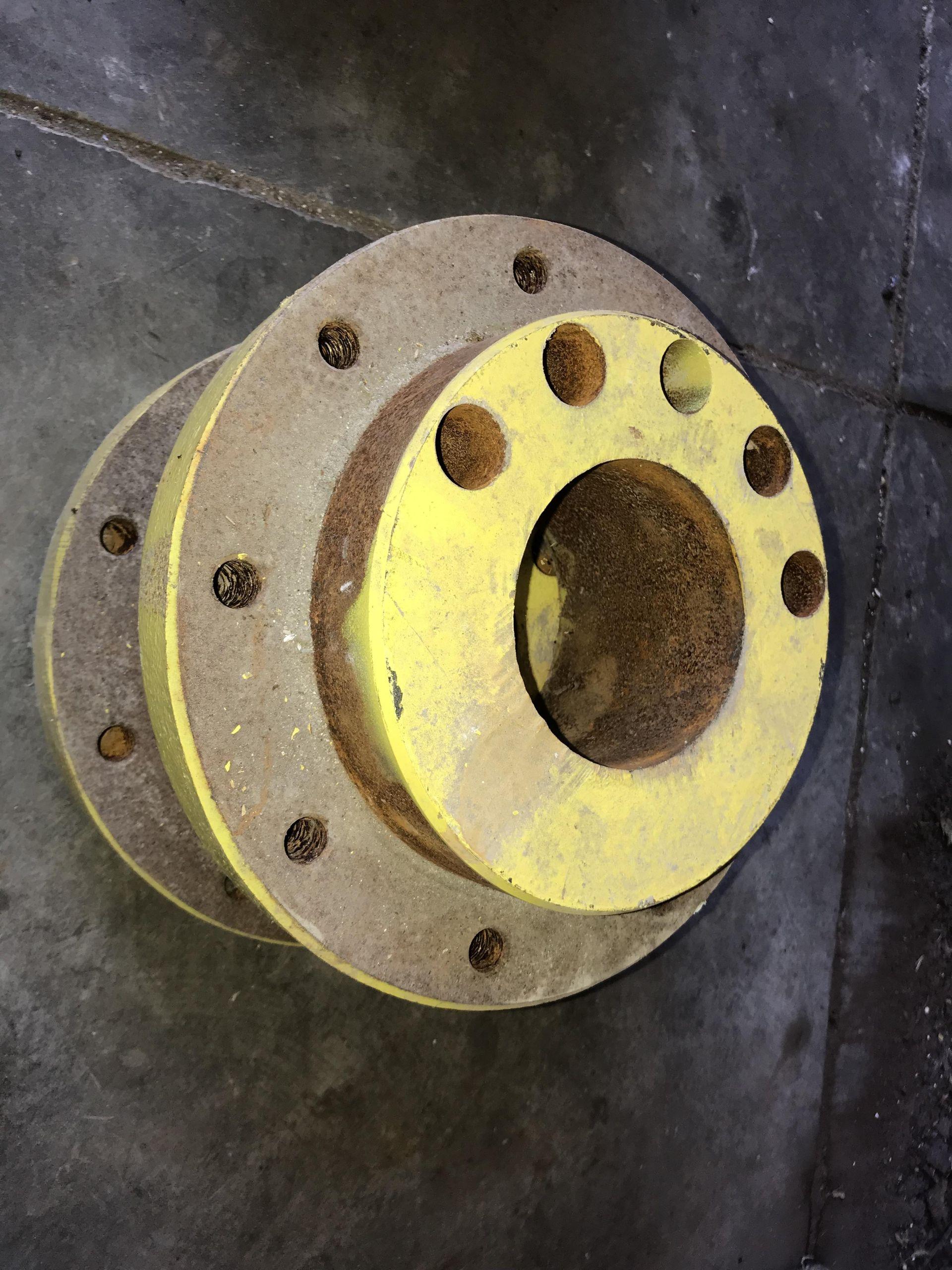 Lot 24 - Pair JD 9 Bolt Hubs (no center wedges or bolts)