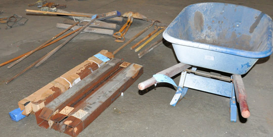 Lot 20 - Lot-Wheel Barrow with Clean-Up Tools and Axe Handles