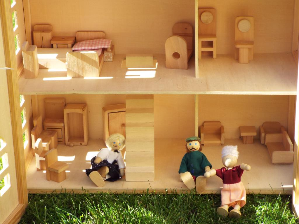Lot 20 - A wooden doll house by Chad Valley, partly furnished with three residents, 60cm x 52cm x 23cm,