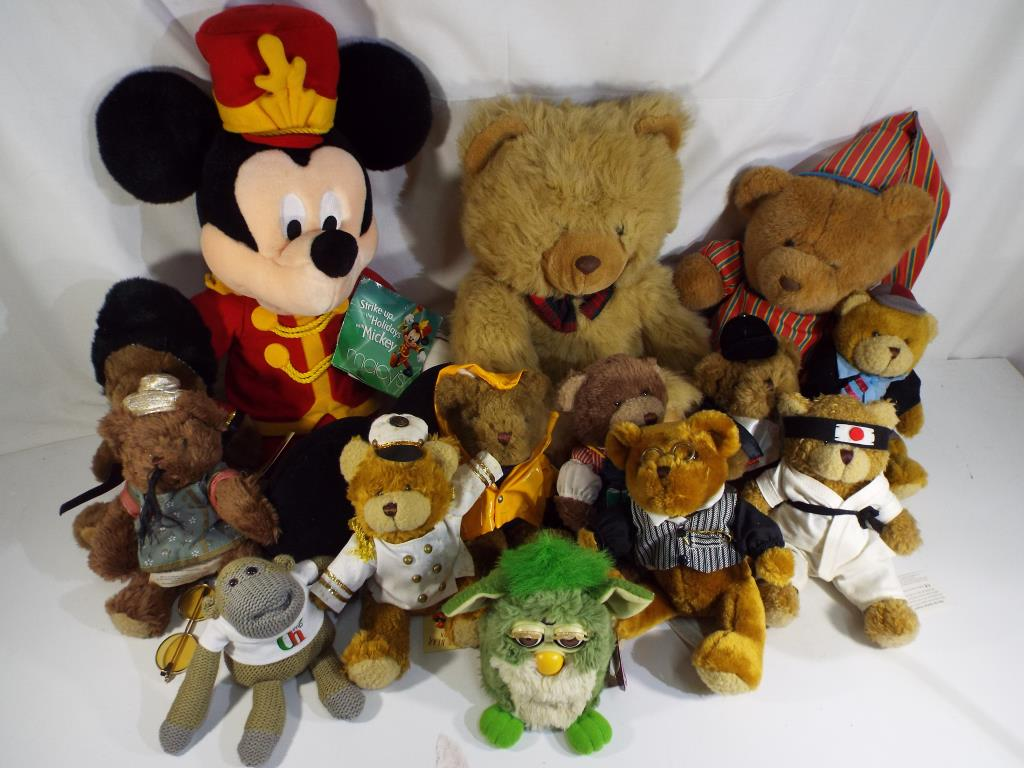 Lot 18 - Bears - a collection of thirteen bears including nine from The Teddy Bear Collection with name tags,