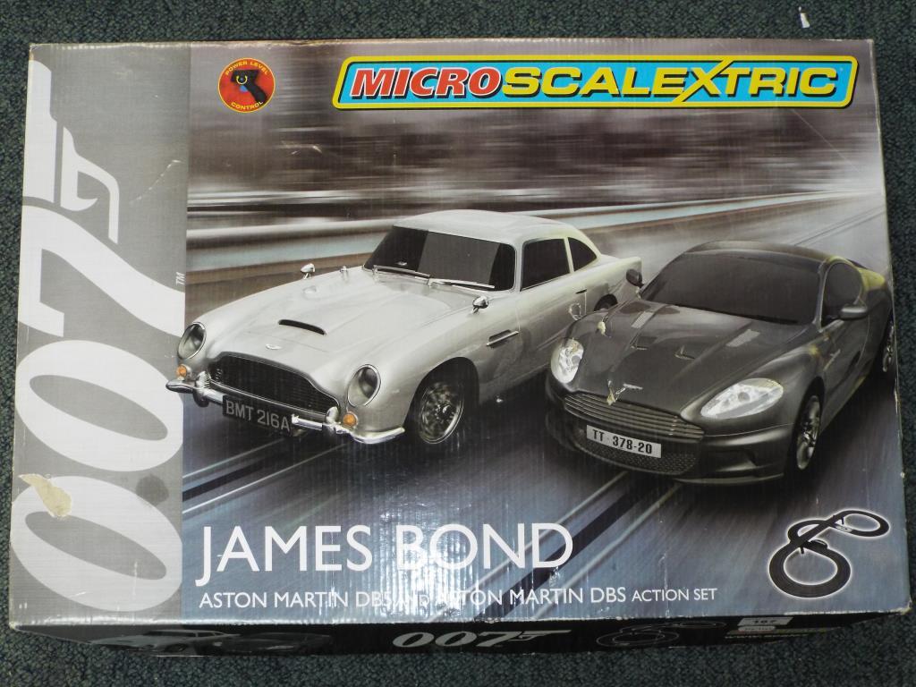 Lot 26 - Scalextric - James Bond micro set featuring Aston Martin DB5 and Aston Martin DBS,
