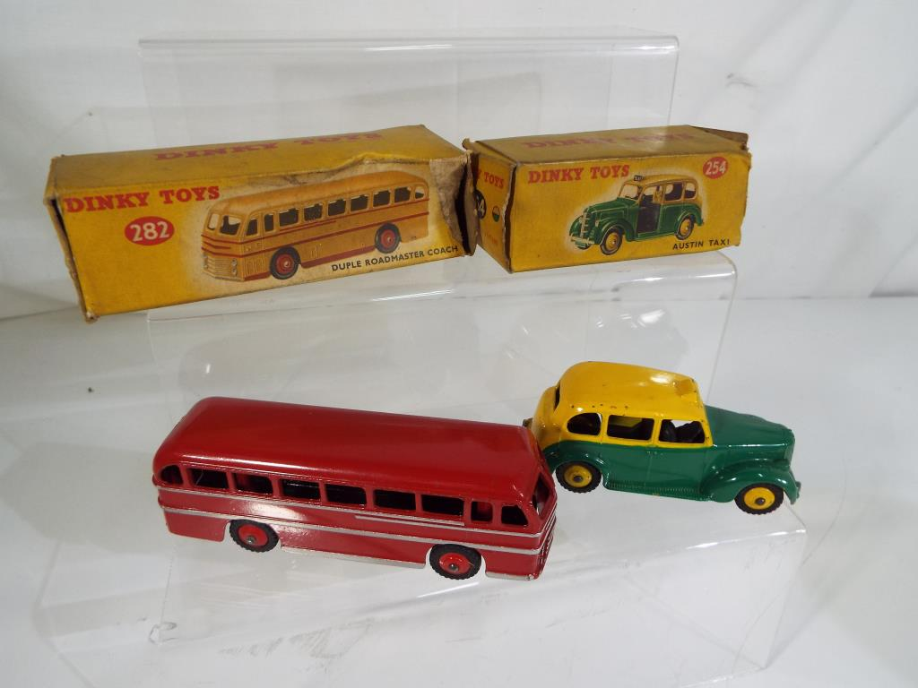 Lot 51 - Dinky Toys - two diecast models comprising a Duple Roadmaster Coach painted in red with silver