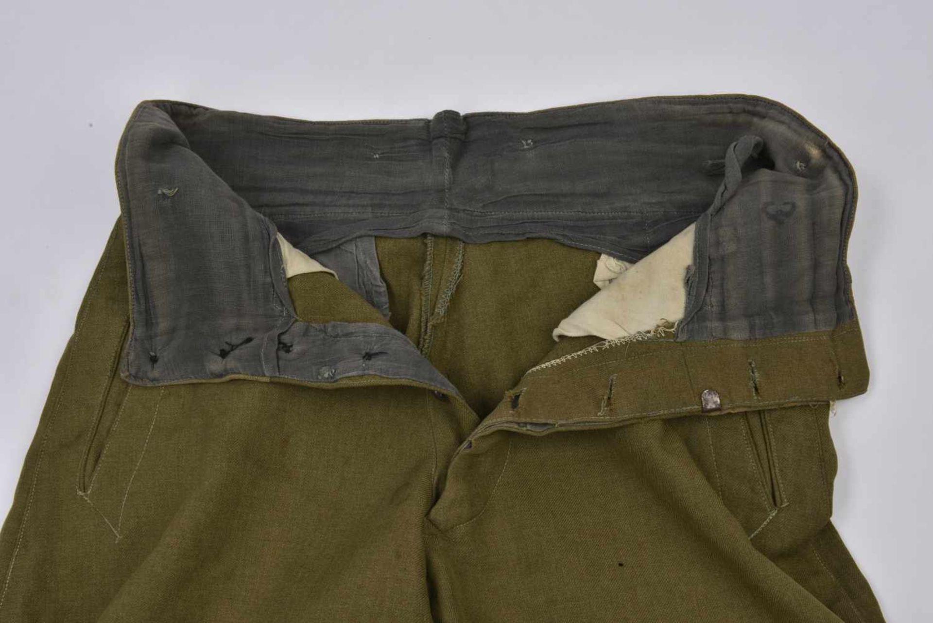 Culotte troupe M.35 en drap lend-lease Bonne taille, quelques petits accrocs. M.35 trousers in the - Bild 3 aus 4