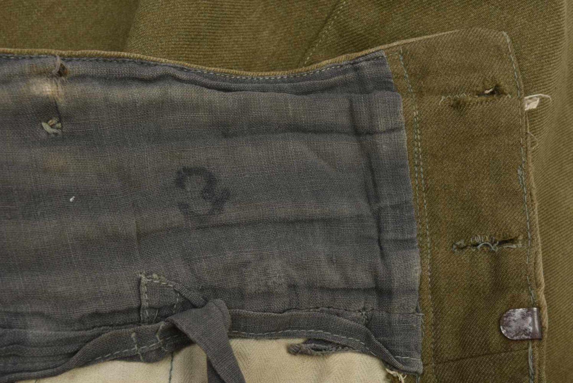 Culotte troupe M.35 en drap lend-lease Bonne taille, quelques petits accrocs. M.35 trousers in the - Bild 2 aus 4