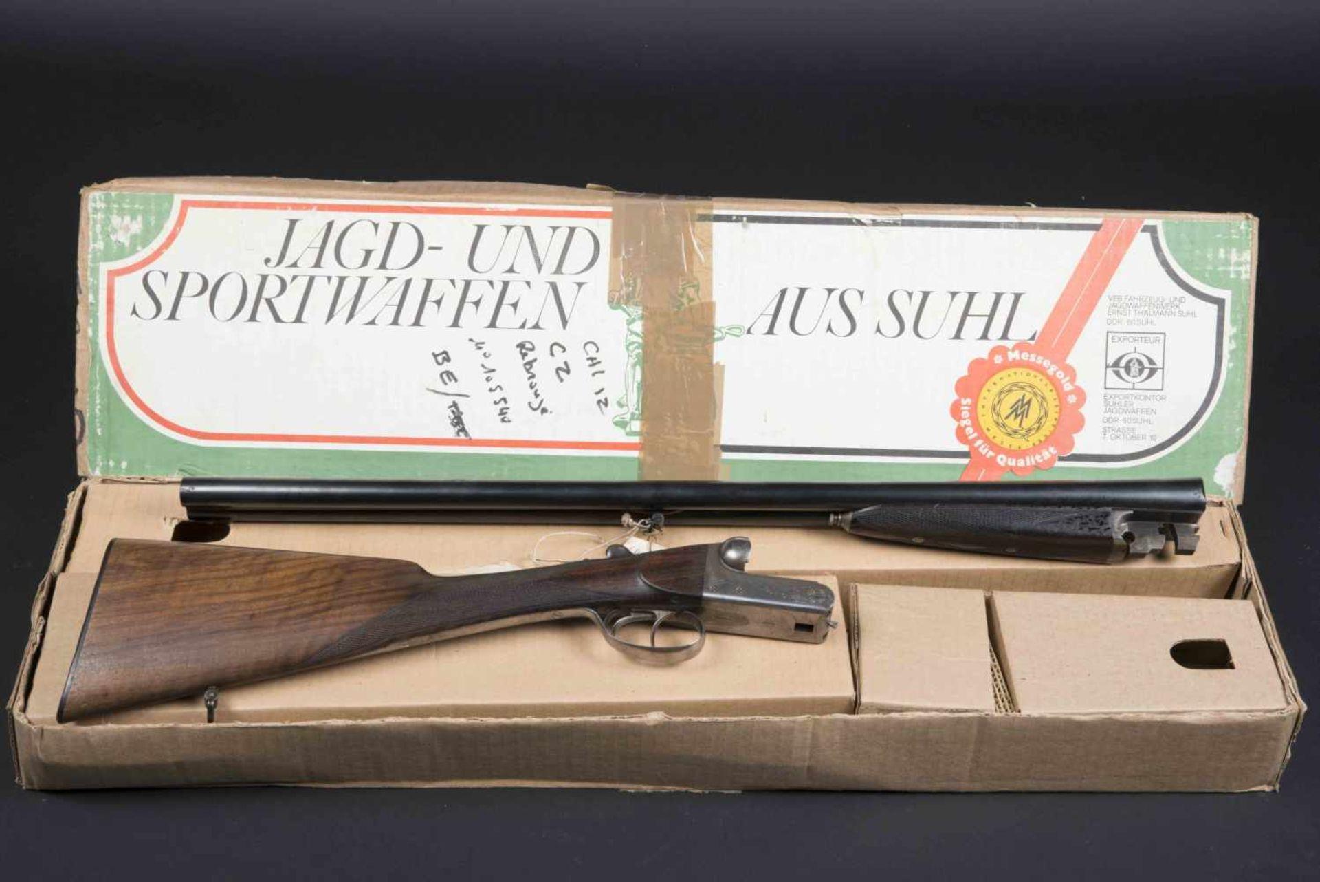 Fusil juxtaposé CZ Catégorie C Magasin juxtaposé, crosse anglaise. Numéro 105540, calibre 12. Carton